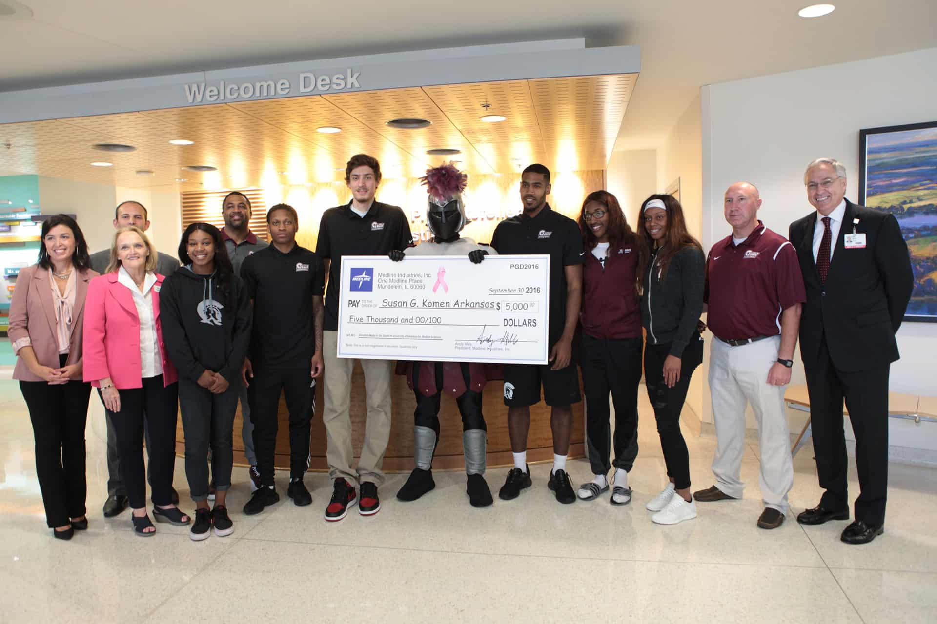 Group shot of check presentation