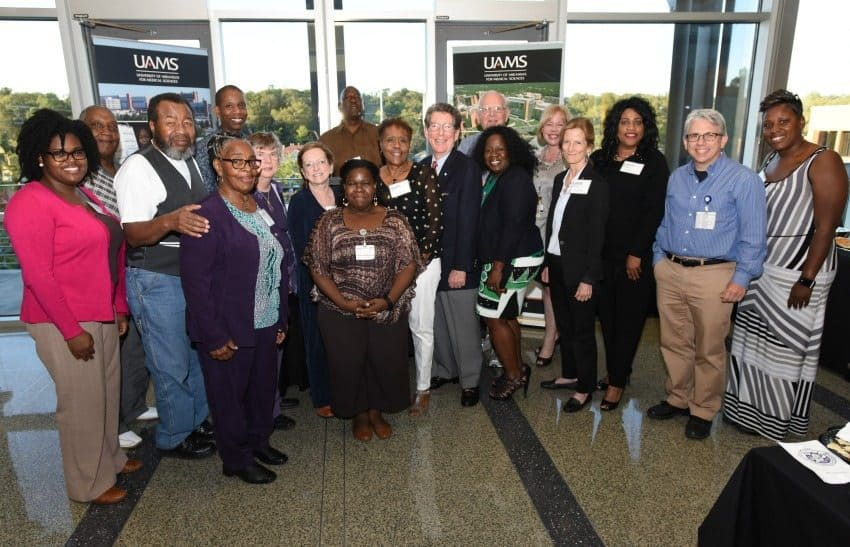 Community Scientist Academy graduates along with UAMS faculty and staff are (l-r): Camille Hart (staff), Charles Moore (back), Carl Farr, Sarah Facen, David Miller (back), Pat Kissire, Virginia Wilhelm, Nicki Spencer (staff), Willie Wade (back), Onie Norman, Larry Taylor, Marvin Hayenga (back), Sylvia Halliburton, Mary Aitken (faculty), Kate Stewart (faculty), Esther Dixon, David Robinson (staff) and Kimberly Moore. (Not pictured: Marilyn Bailey-Jefferson, Freeman McKindra, Suzanne Overgaard and Joy Rockenbach)
