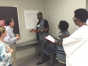 Willie Wade of Hot Springs discusses his idea for a research study during a class exercise.