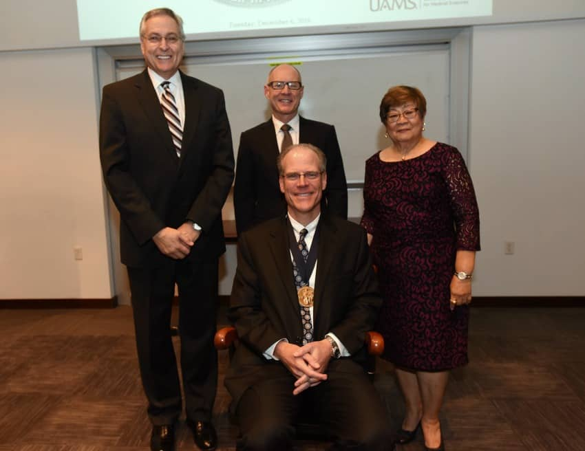 W. Brooks Gentry, M.D., was named the inaugural recipient of the Carmelita S. Pablo Endowed Chair in Anesthesiology. From left to right, back row, are UAMS Chancellor Dan Rahn, M.D., UAMS College of Medicine Dean Pope Moseley, M.D., and Carmelita S. Pablo, M.D.