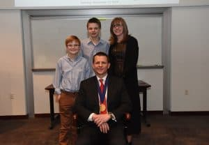 Alan J. Tackett, Ph.D., with his wife, Rebecca, and sons Will and Jack.