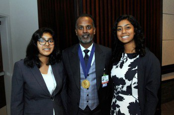 Dr. Seupaul and his two daughters, Savannah and Taylor.
