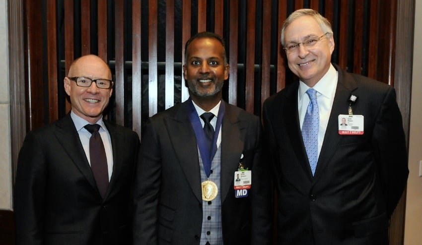 "Rawle A. ""Tony"" Seupaul, M.D., (center) with UAMS Executive Vice Chancellor and College of Medicine Dean Pope L. Moseley, M.D., and Chancellor Dan Rahn, M.D."