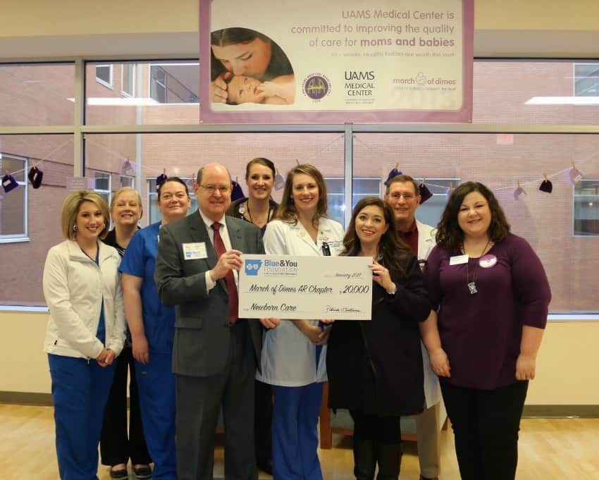 A $20,000 gift from the Blue & You Foundation to the Arkansas chapter of the March of Dimes will benefit the UAMS NICU. From left are UAMS' Courtney Higginbotham, R.N., Ginny Smith, R.N., and Misty Williams, R.N.; Blue & You Foundation's Patrick O'Sullivan; UAMS' Emily Gordon and Rebekah Thacker, R.N.; March of Dimes' Kristin Powell; UAMS' Whitt Hall, M.D., and March of Dimes' Rachel Guerin.