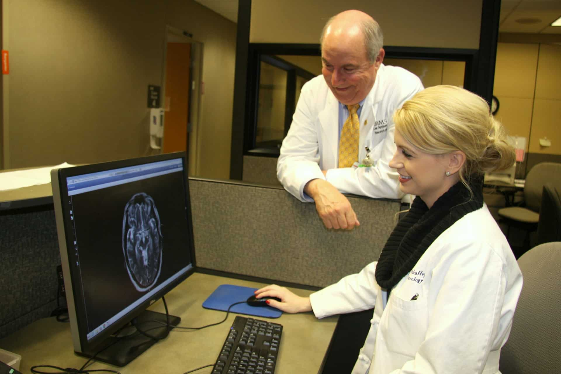 Two doctors look at brain scan