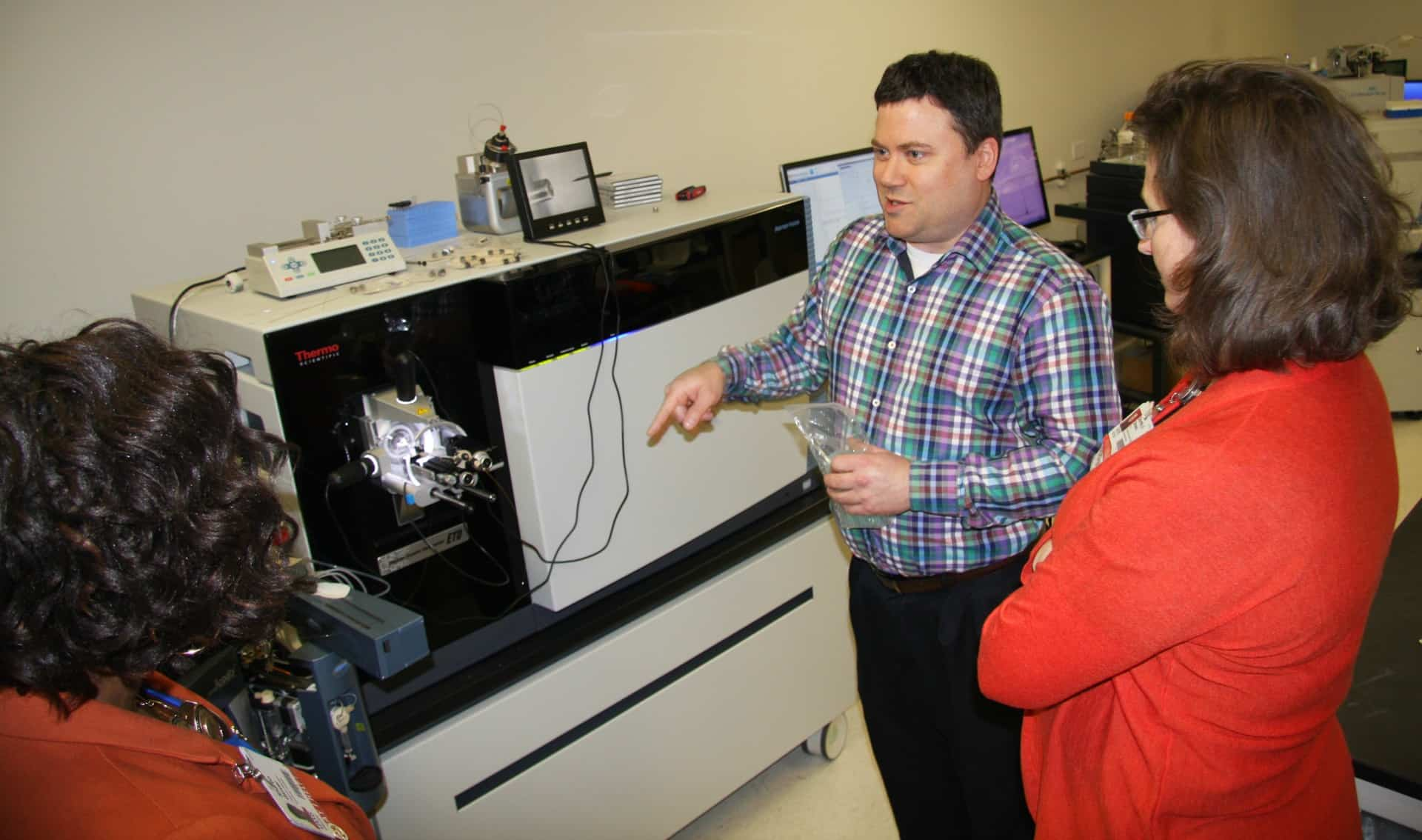 Professor pointing to features of mass spec