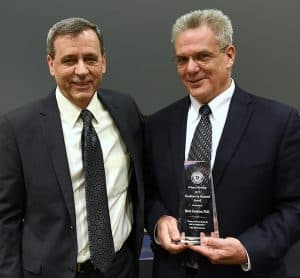 Two doctors with award