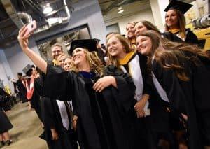 Group of graduates take a selfie