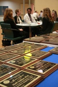 Award plaques and people socializing