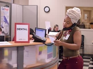 LaTasha Poore, a Master of Public Health student who volunteers as a translator at the 12th Street clinic, speaks to a patient on the telephone.