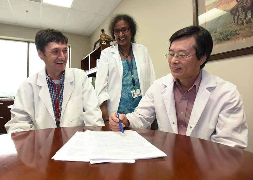 UAMS' Craig Forrest, Ph.D., (left), credits his former mentors, Usha Ponnappan, Ph.D., and Xuming Zhang, Ph.D., D.V.M., with his early success.