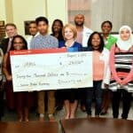 Students who took part in the Center for Diversity Affairs' summer enrichment programs pose with center staff and Bank of America representatives Donnie Cook (back row, fifth from left) and Heather Albright (front row, holding check).
