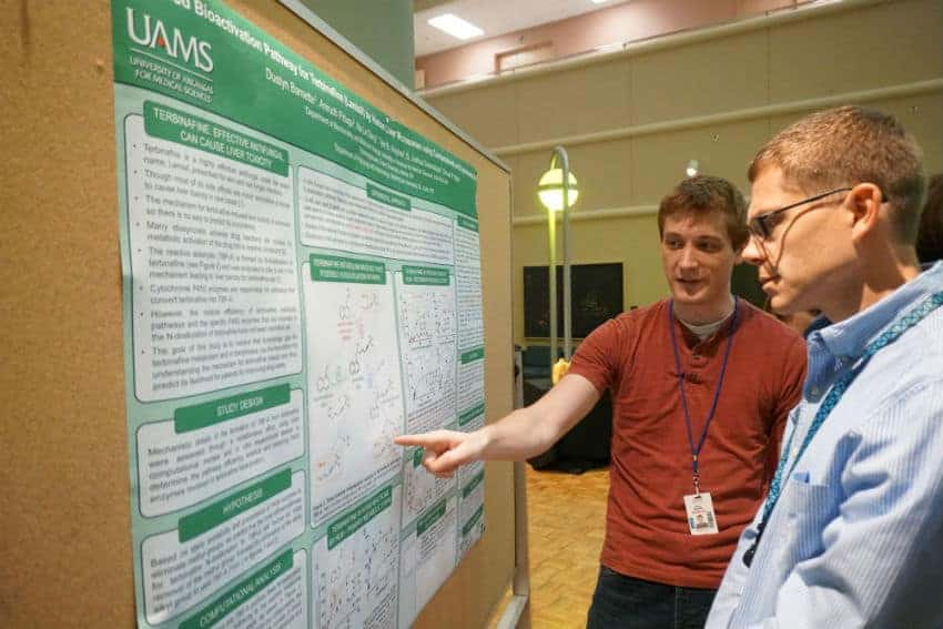 Dustyn Barnette, a third-year graduate student, discusses his research with Jason Stumhofer, Ph.D.