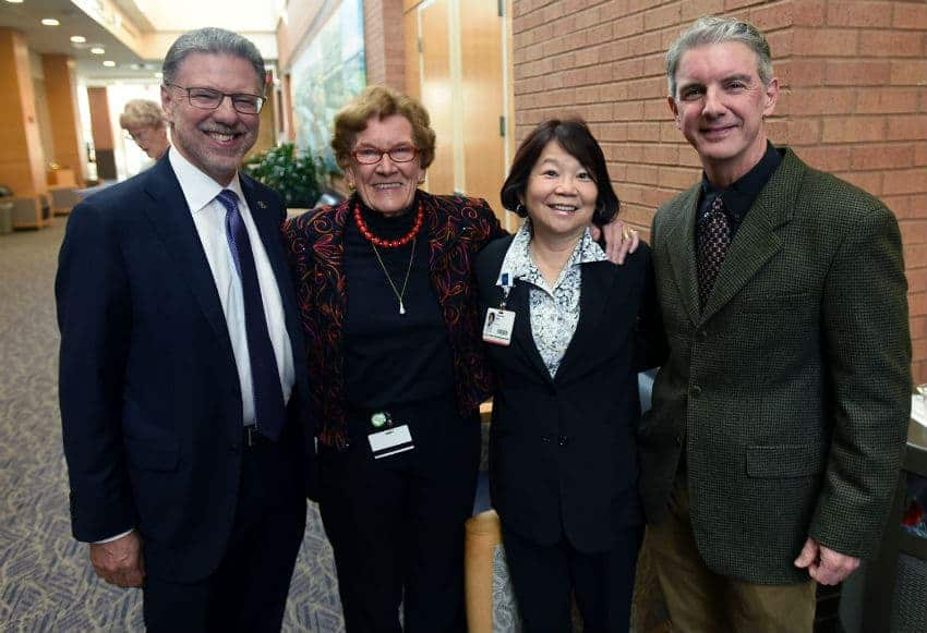 Harry Johns, left, with Jeanne Wei, M.D., Ph.D., Sue Griffin, Ph.D., and Steve Barger, Ph.D. at a reception prior to the STOP Alzheimer's Forum on Oct. 30.