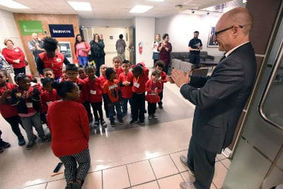 UAMS Executive Vice Chancellor and College of Medicine Dean Pope L. Moseley, M.D., applauded the children's caroling and wished them a happy holiday season.