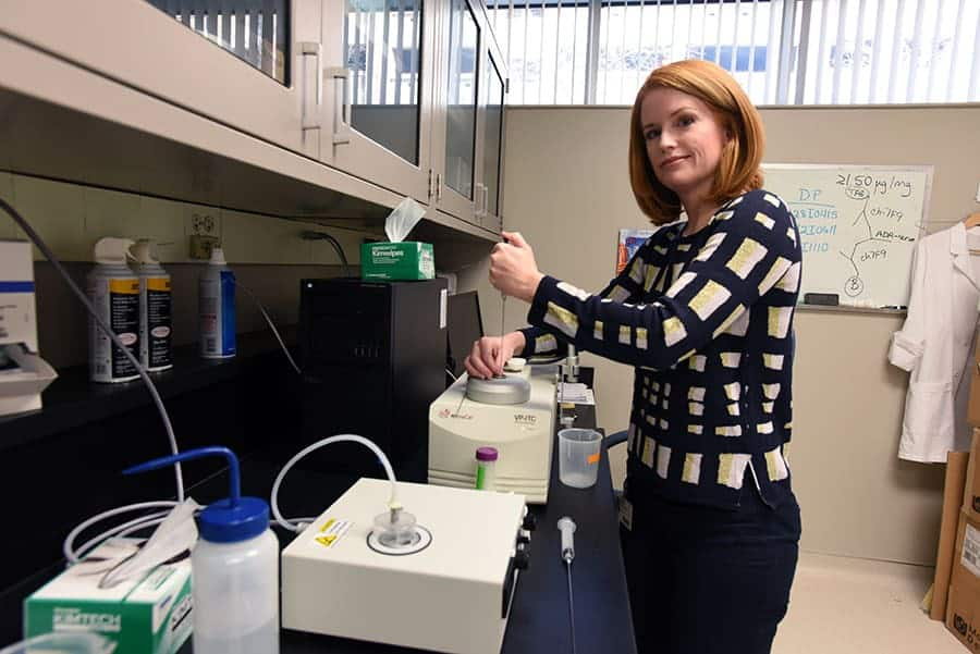 Misty Stevens demonstrates one of the lab procedures InterveXion uses in the development of the monoclonal antibody it is studying for possible future use in the treatment of methamphetamine addiction.