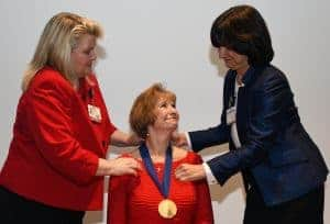McSweeney was invested into the professorship by Patricia Cowan (left), Ph.D., R.N., dean of the UAMS College of Nursing, and interim UAMS Chancellor Stephanie Gardner, Pharm.D., Ed.D.