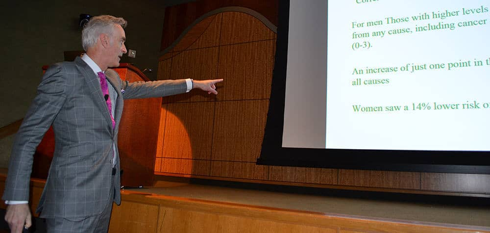 Timothy Harlan, M.D., points at the screen to emphasize a point during his presentation at the 23rd annual Diabetes Update Symposium.