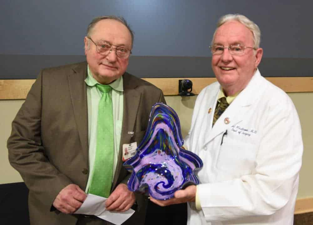 Two doctors with glass bowl