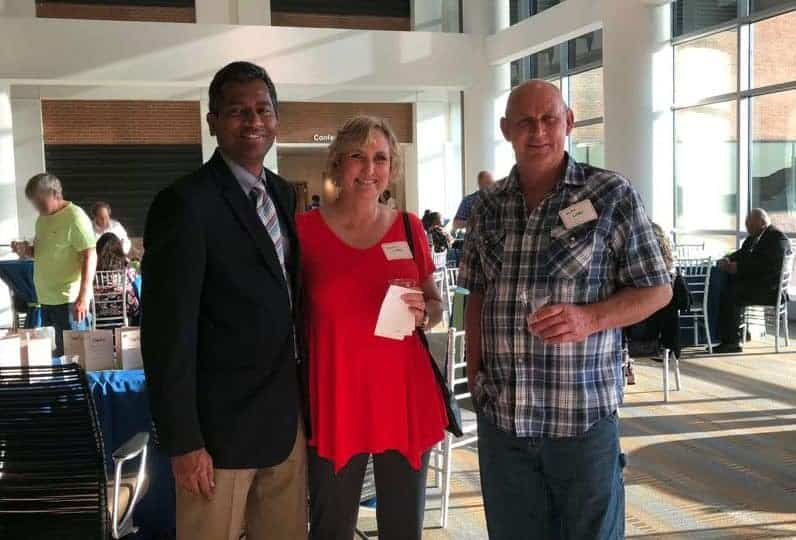 Allogeneic stem cell transplant recipient Dottie Lobbs (center) joined her physician, Muthu Veeraputhiran, M.D., (left) and husband Mike Lobbs at the first-ever UAMS Cancer Institute's Celebration of Life.