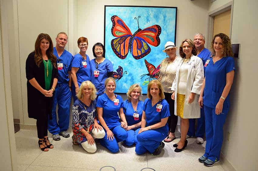 """El Dorado artist Melinda Cameron-Godsey (fourth from right) celebrated the installation of her painting titled """"Hope"""" at the UAMS Winthrop P. Rockefeller Cancer Institute. She is joined by Liudmila Schafer, M.D. (third from right); daughter Courtney Cassinelli (far left); friends; and oncology nurses."""