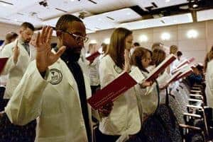 The Physician Assistant Class of 2020 recites the PA Professional Oath after the students received their white coats.