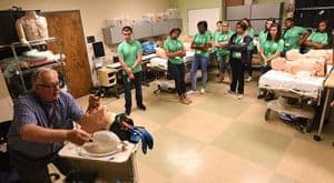 Pharmacy Camp students receive instruction in intubation in the UAMS Simulation Center.