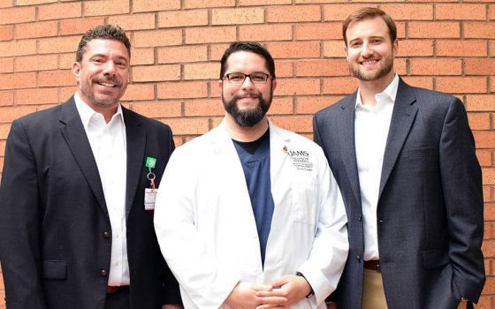 "<p>College of Pharmacy students Zach Smith (center) and Matt Garner (right) played major roles in the creation of dozens of YouTube videos containing pharmacist-level drug counseling for patients. Seth Heldenbrand, Pharm.D., (left) the college's associate dean of experiential education, conceived and oversaw the project.</p> <div><a class=""more"" href=""https://news.uams.edu/2018/07/02/pharmacy-students-create-drug-counseling-videos-for-youtube-2/pharmacy/"">Read more</a></div>"