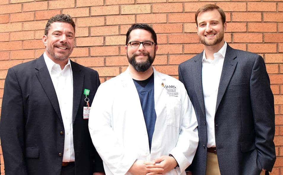College of Pharmacy students Zach Smith (center) and Matt Garner (right) played major roles in the creation of dozens of YouTube videos containing pharmacist-level drug counseling for patients. Seth Heldenbrand, Pharm.D., (left) the college's associate dean of experiential education, conceived and oversaw the project.