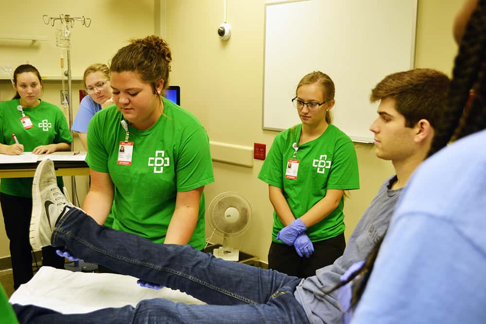 MASH students visiting the UAMS Simulation Center roleplay diagnosing a stroke patient through the AR SAVES network.