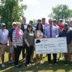 Close to two dozen Hat Club members collectively presented a check July 13 to UAMS Consortium board members.
