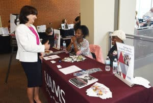 Stephanie Gardner, Pharm.D., Ed. D., senior vice chancellor of Academic Affairs and provost, visits the Center for Diversity Affairs booth at the Faculty Resource Fair.