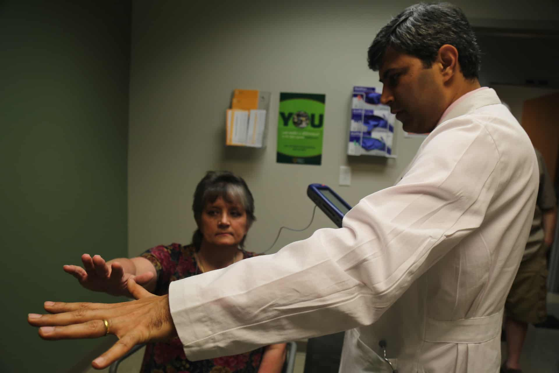 Kimberly Zimmer visits neurologist Rohit Dhall, M.D., to check the results of her deep brain stimulation surgery.