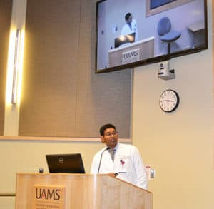 Dr. Sanjeeva Enteddu speaking at conference