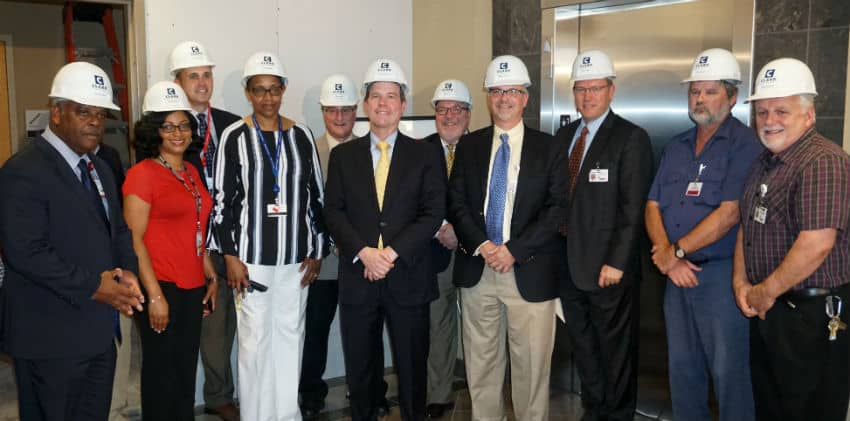 UAMS Chancellor Cam Patterson, M.D., MBA (center) attended the groundbreaking ceremony and received a hart hat. To his left is Toni Middleton, M.D., with Sterling Moore at far left; to his right are Mark Deal (center, back row), Wesley Trussell, JRMC assistant vice president for facilities and support, and Brian Thomas (right of Trussell), JRMC CEO.