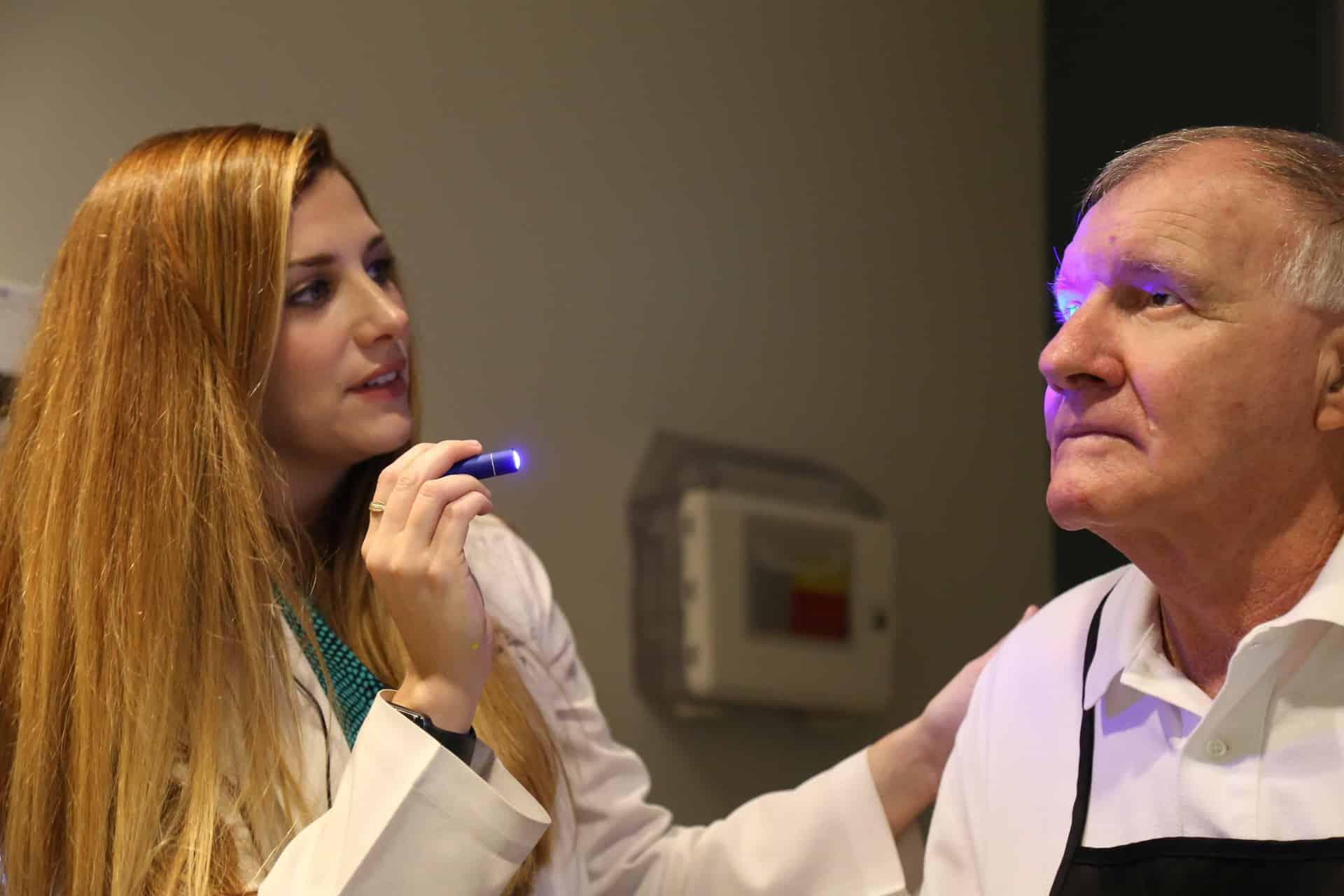 Katie Brown, O.D. examines Mack Farris' eye.