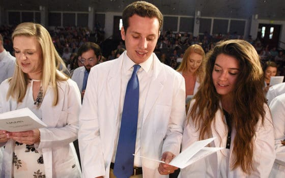 "<p>After receiving their white coats, members of the College of Pharmacy's Class of 2022 recite the Student Pledge of Professionalism.</p> <div><a class=""more"" href=""https://news.uams.edu/2018/09/10/college-of-pharmacy-class-of-2022-dons-white-coats/cop-whitecoat-featured/"">Read more</a></div>"