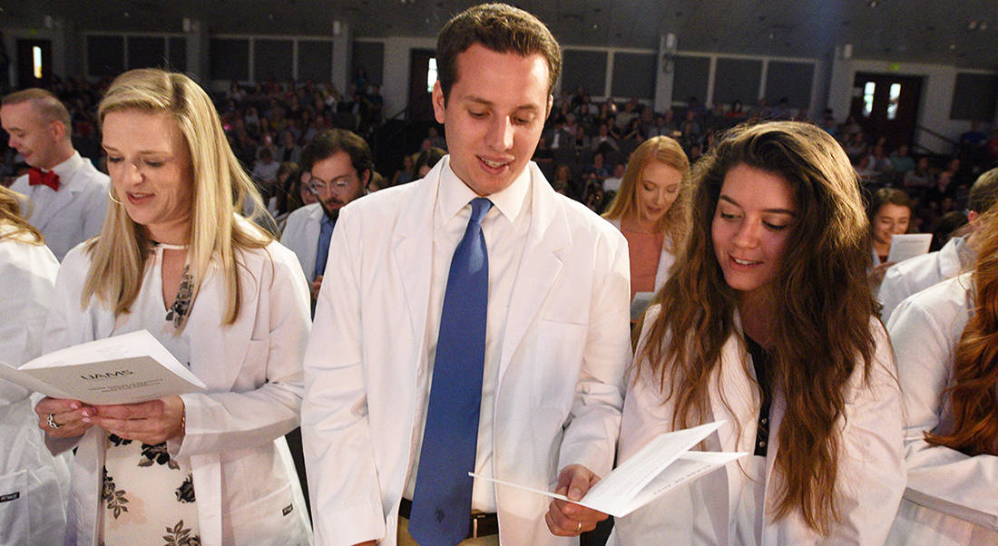 After receiving their white coats, members of the College of Pharmacy's Class of 2022 recite the Student Pledge of Professionalism.