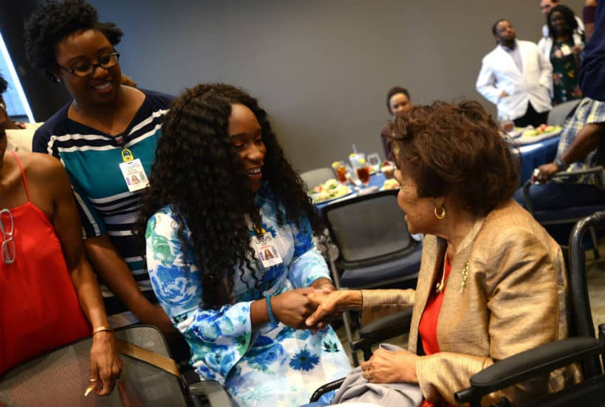 First-year medical students Brittany Demmings and Tia'Asia James meet Edith Irby Jones, M.D. (at right) after receiving scholarships created in her name.