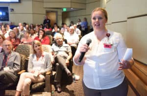 Rebecca Hulsey, R.N., asks the chancellor a question during the Town Hall.