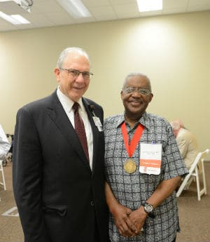 Henry Foster Jr., M.D., COM '58, with College of Medicine Dean Chris Westfall, M.D.
