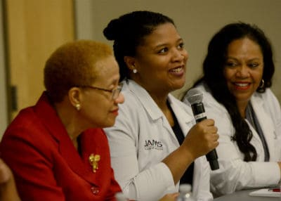 Sasha Ray (center) responds to a question as part of a four-woman panel discussing struggles in the medical field.