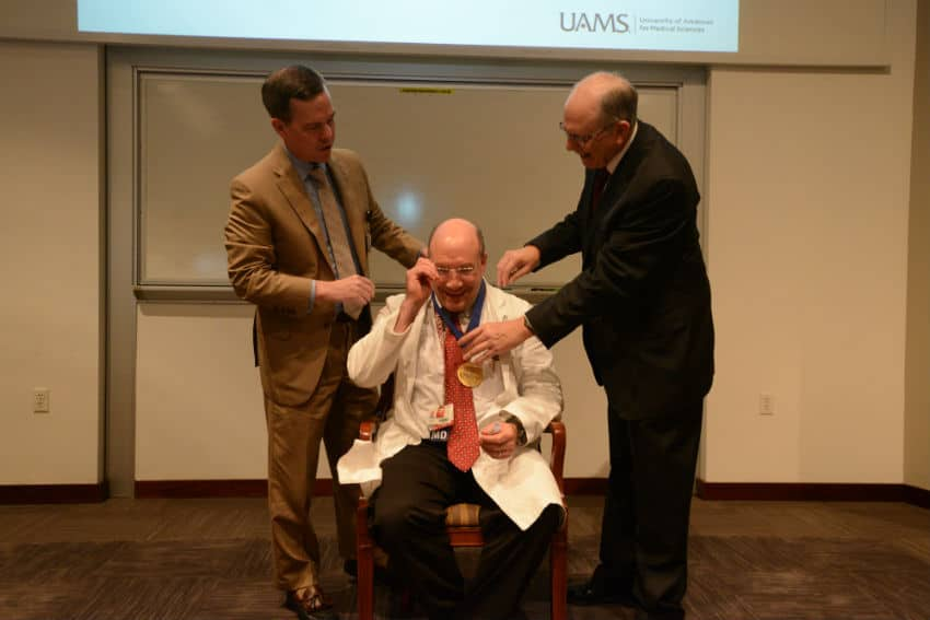 Seth Berney, M.D., receives his commemorative medallion from Chancellor Cam Patterson, M.D., MBA, and College of Medicine Dean Christopher T. Westfall, M.D.