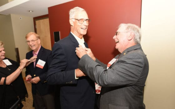 "<p>Jack Blackshear Jr., M.D., COM '68 (at right), pins a button on George Fielder Jr., M.D., COM '68 at the Friday night welcome reception.</p> <div><a class=""more"" href=""https://news.uams.edu/2018/09/07/passion-dedication-still-evident-for-graduates-at-alumni-weekend-2018/dsc_9505e/"">Read more</a></div>"
