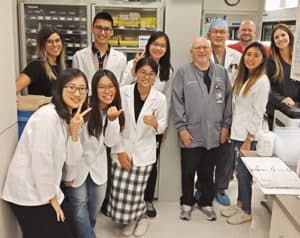 The pharmacy students from Kaohsiung tour a community pharmacy during their visit.