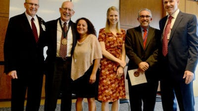 """William """"Bill"""" Ventres, M.D. (second from left) with his wife, Estella, and daughter Cory, as well as (from left) College of Medicine Dean Christopher Westfall, M.D., Erick Messias, M.D. and Daniel Knight, M.D."""