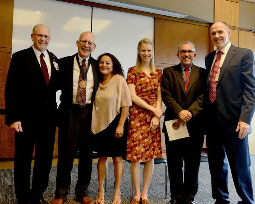 "William ""Bill"" Ventres, M.D. (second from left) with his wife, Estella, and daughter Cory, as well as (from left) College of Medicine Dean Christopher Westfall, M.D., Erick Messias, M.D. and Daniel Knight, M.D."
