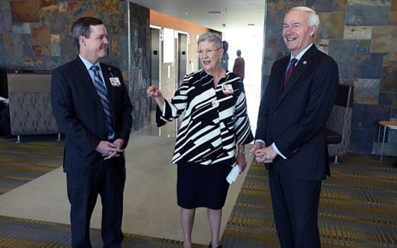 Winthrop P. Rockefeller Cancer Institute Interim Director Laura Hutchins, M.D., (center) leads Arkansas Gov. Asa Hutchinson (right) and UAMS Chancellor Cam Patterson, M.D., MBA, on a tour of the Cancer Institute.