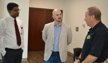 Sanjeeva Onteddu, M.D., left, talks with State Sen. Trent Garner and Ken Kelley, ProMed Ambulance Service CEO, about the AR SAVES program.