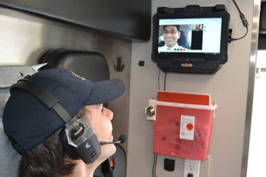 Nich Miller, ProMed paramedic, talks with Onteddu via a live video connection in a ProMed Ambulance.